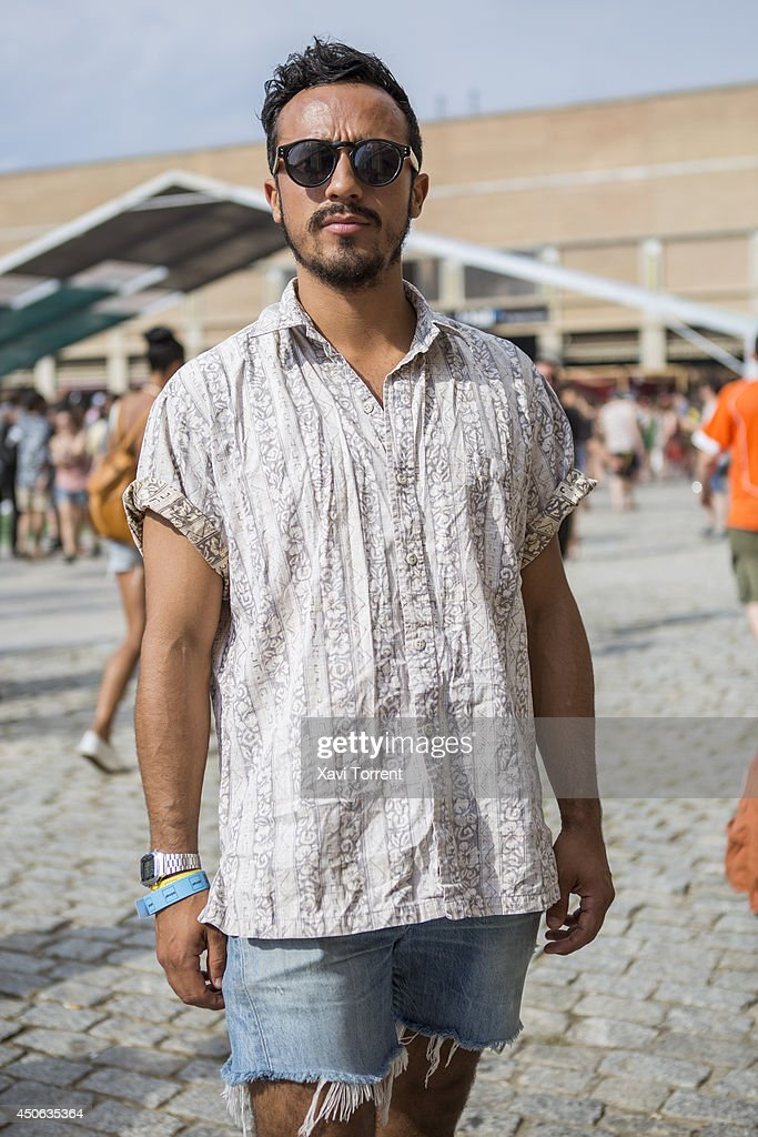 Sergio is wearing a vintage shirt, jeans from Levis Twisted 1999 and sunglasses Kamono at the Sonar Music Festival on June 14, 2014 in Barcelona, Spain.