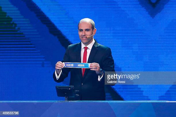 Sergio Jadue President of the Chilean Football Federation holds up the name of Brazil during the Official Draw of Copa America 2015 at Quinta Vergara...