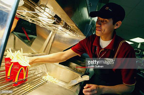Sergio Laua works the french fry counter at a McDonald's restaurant July 29 2003 in Redwood City California McDonald's Corporation today reported...