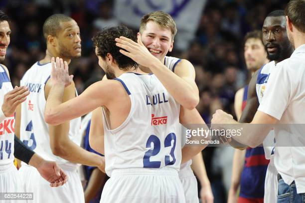 Sergio Llull #23 guard of Real Madrid and Luka Doncic #7 guard of Real Madrid celebrates the victory at the end of the Liga Endesa game between Real...