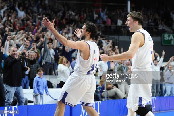 Sergio Llull #23 guard of Real Madrid and Luka Doncic #7 guard of Real Madrid celebrates the victory during the Liga Endesa game between Real Madrid...