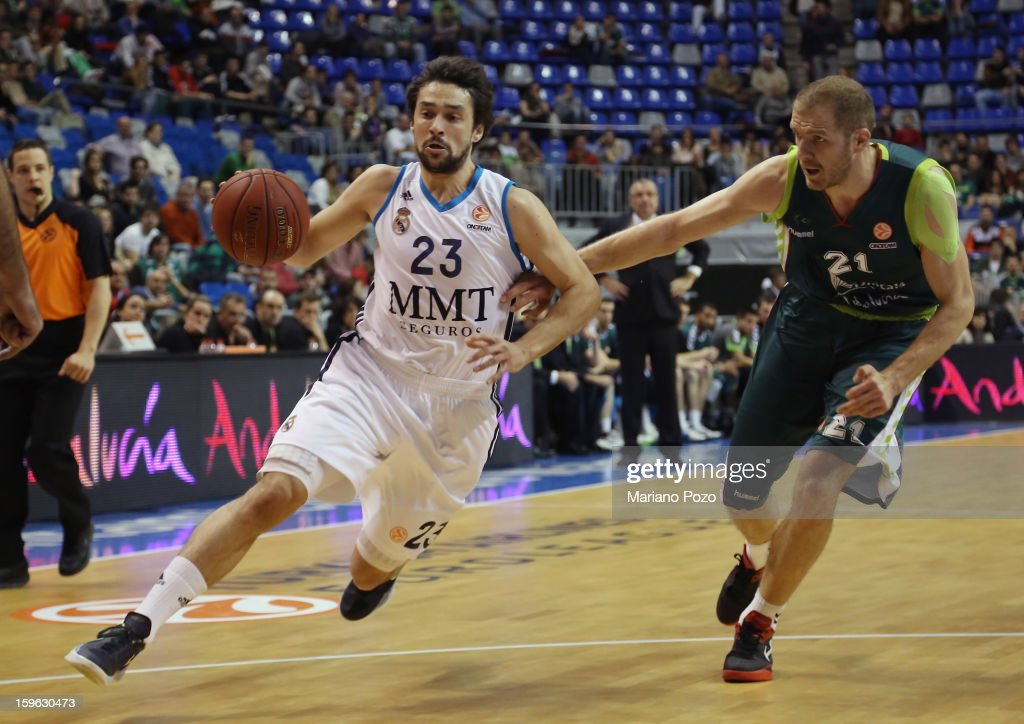 <a gi-track='captionPersonalityLinkClicked' href=/galleries/search?phrase=Sergio+Llull&family=editorial&specificpeople=4537823 ng-click='$event.stopPropagation()'>Sergio Llull</a>, #23 of Real Madrid and Luca Zoric, #21 of Unicaja Malaga in action during the 2012-2013 Turkish Airlines Euroleague Top 16 Date 4 between Unicaja Malaga v Real Madrid at Palacio Deportes Martin Carpena on January 17, 2013 in Malaga, Spain.