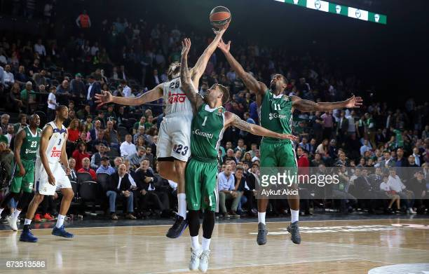 Sergio Llull #23 of Real Madrid competes with Bradley Wanamaker #11 of Darussafaka Dogus Istanbul Scottie Wilbekin #1 of Darussafaka Dogus Istanbul...