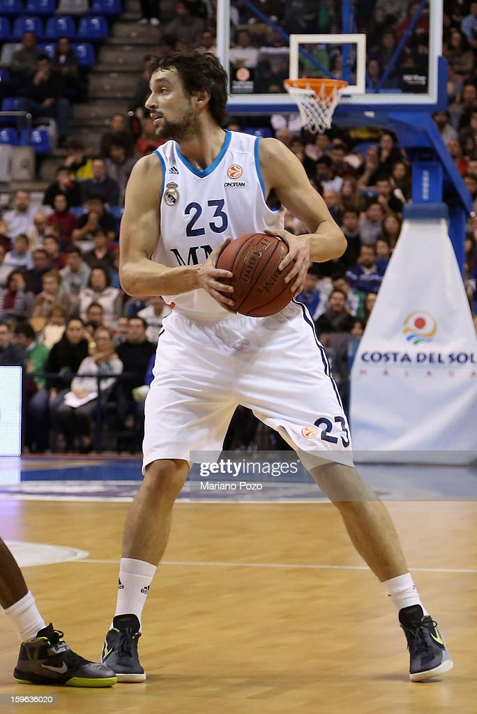 <a gi-track='captionPersonalityLinkClicked' href=/galleries/search?phrase=Sergio+Llull&family=editorial&specificpeople=4537823 ng-click='$event.stopPropagation()'>Sergio Llull</a>, #23 of Real Madrid in action during the 2012-2013 Turkish Airlines Euroleague Top 16 Date 4 between Unicaja Malaga v Real Madrid at Palacio Deportes Martin Carpena on January 17, 2013 in Malaga, Spain.
