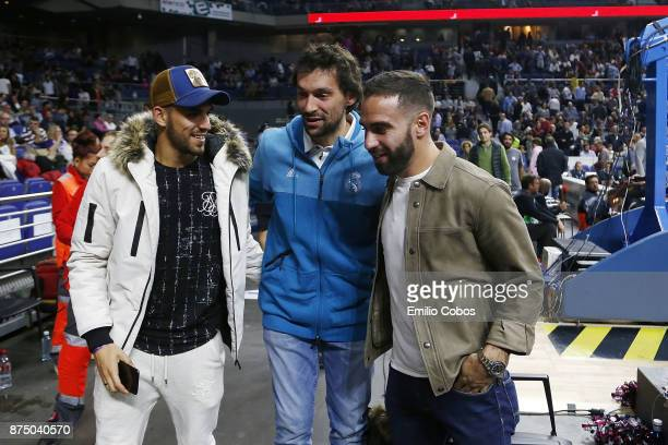 Sergio Llull #23 of Real Madrid talks with Real Madrid Football players Dani Ceballos and Daniel Carvajal during the 2017/2018 Turkish Airlines...
