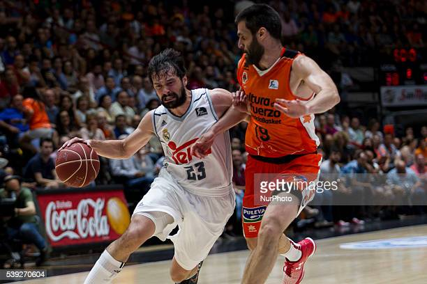 23 Sergio Llull of Real Madrid Basket and 19 Fernando San Emeterio of Valencia Basket during Endesa league basketball in fourth semifinals match...
