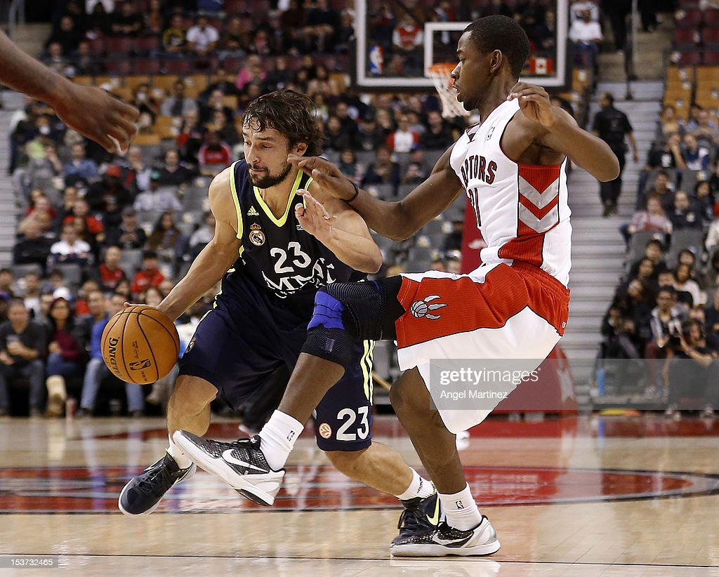 <a gi-track='captionPersonalityLinkClicked' href=/galleries/search?phrase=Sergio+Llull&family=editorial&specificpeople=4537823 ng-click='$event.stopPropagation()'>Sergio Llull</a> #23 of Real Madrid drives against <a gi-track='captionPersonalityLinkClicked' href=/galleries/search?phrase=Terrence+Ross&family=editorial&specificpeople=6781663 ng-click='$event.stopPropagation()'>Terrence Ross</a> #31 of the Toronto Raptors during the Euroleague American Tour 12 game at Air Canada Centre on October 8, 2012 in Toronto, Ontario, Canada.