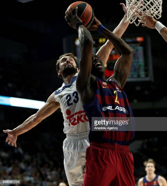 Sergio Llull of Real Madrid in action against Moussa Diagne of Barcelona Lassa during the Turkish Airlines Euroleague basketball match between Real...