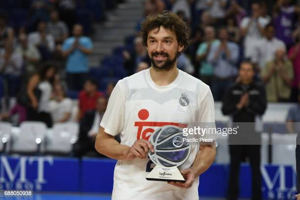 Sergio Llull of Real Madrid poses with his MVP trophy during the 20162017 basketball Endesa league at WinZink center in Madrid Real Madrid beat...
