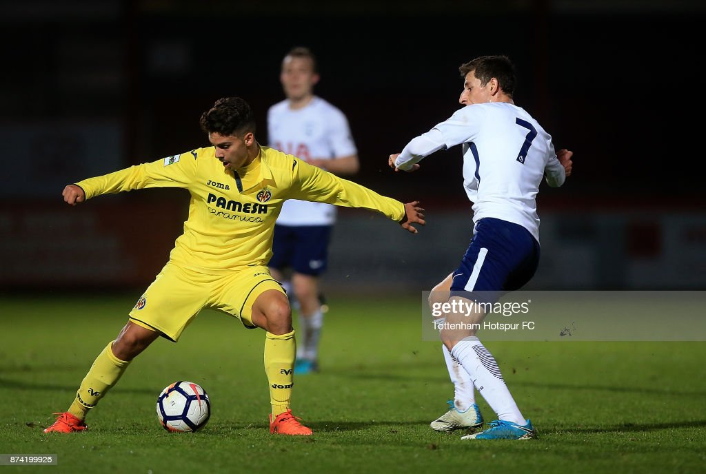 Sergio Lozano of Villarreal holds off pressure from Jack Roles of Tottenham during the Premier League International Cup match between Tottenham Hotspur and Villarreal at The Lamex Stadium on November 14, 2017 in Stevenage, England.
