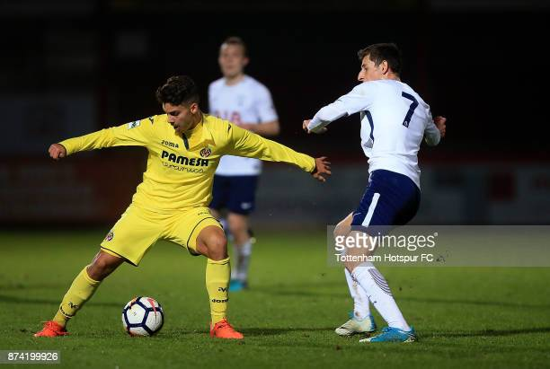 Sergio Lozano of Villarreal holds off pressure from Jack Roles of Tottenham during the Premier League International Cup match between Tottenham...
