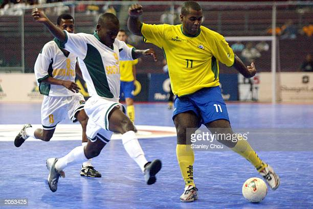 Sergio Luis of Brazil is challenged by Stanley Msiza of South Africa during the 2003 World 5s Futsal Championship between Brazil and South Africa on...