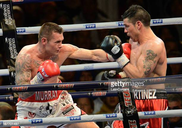 Sergio Maravilla Martinez from Argentina and Martin Murray from England trade punches during the WBC middleweight world championship combat at Jose...