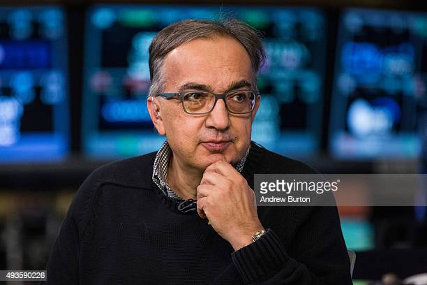 Sergio Marchionne CEO of Fiat Chrysler Automobiles gives an interview while on the floor of the New York Stock Exchange after Ferrari's IPO on...