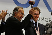 Sergio Marchionne Chief Executive Officer Fiat Chrysler Automobiles and John Elkann Chairman Fiat Chrysler Automobiles ring the Closing Bell on the...
