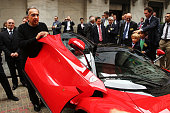 Sergio Marchionne Chief Executive Officer Fiat Chrysler Automobiles is viewed next to a Ferrari after ringing the Closing Bell on the floor of the...