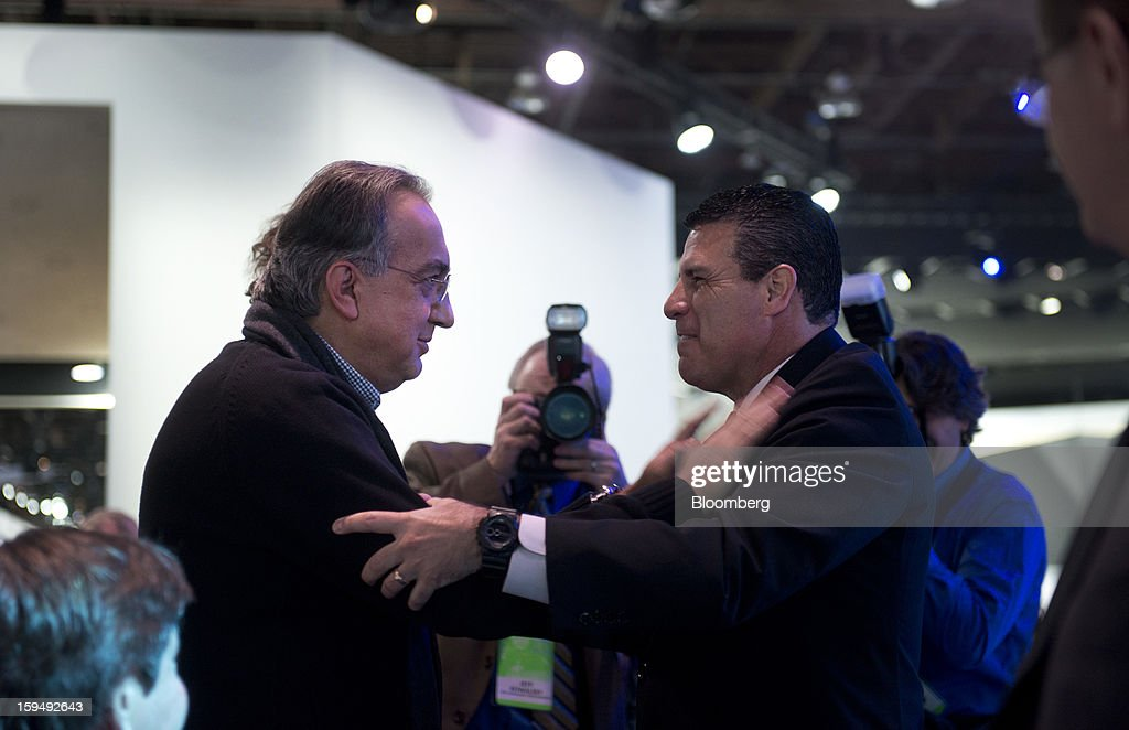 Sergio Marchionne, chief executive officer of Chrysler Group LLC and Fiat SpA, left, greets an attendee during the 2013 North American International Auto Show (NAIAS) in Detroit, Michigan, U.S., on Monday, Jan. 14, 2013. The Detroit auto show runs through Jan. 27 and will display over 500 vehicles, representing the most innovative designs in the world. Photographer: Daniel Acker/Bloomberg via Getty Images