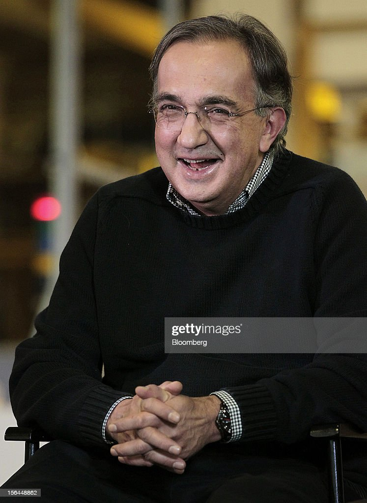 <a gi-track='captionPersonalityLinkClicked' href=/galleries/search?phrase=Sergio+Marchionne&family=editorial&specificpeople=608333 ng-click='$event.stopPropagation()'>Sergio Marchionne</a>, chief executive officer of Fiat SpA and Chrysler Group LLC, smiles during an event at the Chrysler Mack I Engine Plant in Detroit, Michigan, U.S., on Thursday, Nov. 15, 2012. Chrysler Group LLC, the automaker planning to merge with Fiat SpA, will add 1,250 workers at three U.S. plants to boost output of pickups and engines. Photographer: Jeff Kowalsky/Bloomberg via Getty Images