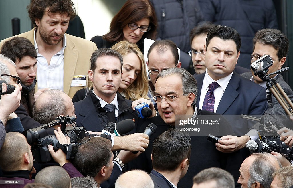 Sergio Marchionne, chief executive officer of Fiat SpA, center, speaks to journalists as he leaves an event at the Borsa Italiana, Italy's stock exchange, in Milan, Italy, on Thursday, Jan. 17, 2013. Chrysler Group LLC and its majority owner Fiat SpA reached a preliminary agreement with joint-venture partner Guangzhou Automobile Group Co. to make Jeep sport-utility vehicles in China for sale in that market. Photographer: Alessia Pierdomenico/Bloomberg via Getty Images