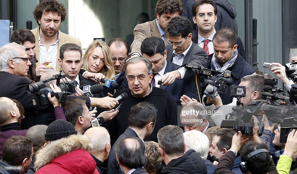 <a gi-track='captionPersonalityLinkClicked' href=/galleries/search?phrase=Sergio+Marchionne&family=editorial&specificpeople=608333 ng-click='$event.stopPropagation()'>Sergio Marchionne</a>, chief executive officer of Fiat SpA, center, speaks to journalists as he leaves an event at the Borsa Italiana, Italy's stock exchange, in Milan, Italy, on Thursday, Jan. 17, 2013. Chrysler Group LLC and its majority owner Fiat SpA reached a preliminary agreement with joint-venture partner Guangzhou Automobile Group Co. to make Jeep sport-utility vehicles in China for sale in that market. Photographer: Alessia Pierdomenico/Bloomberg via Getty Images