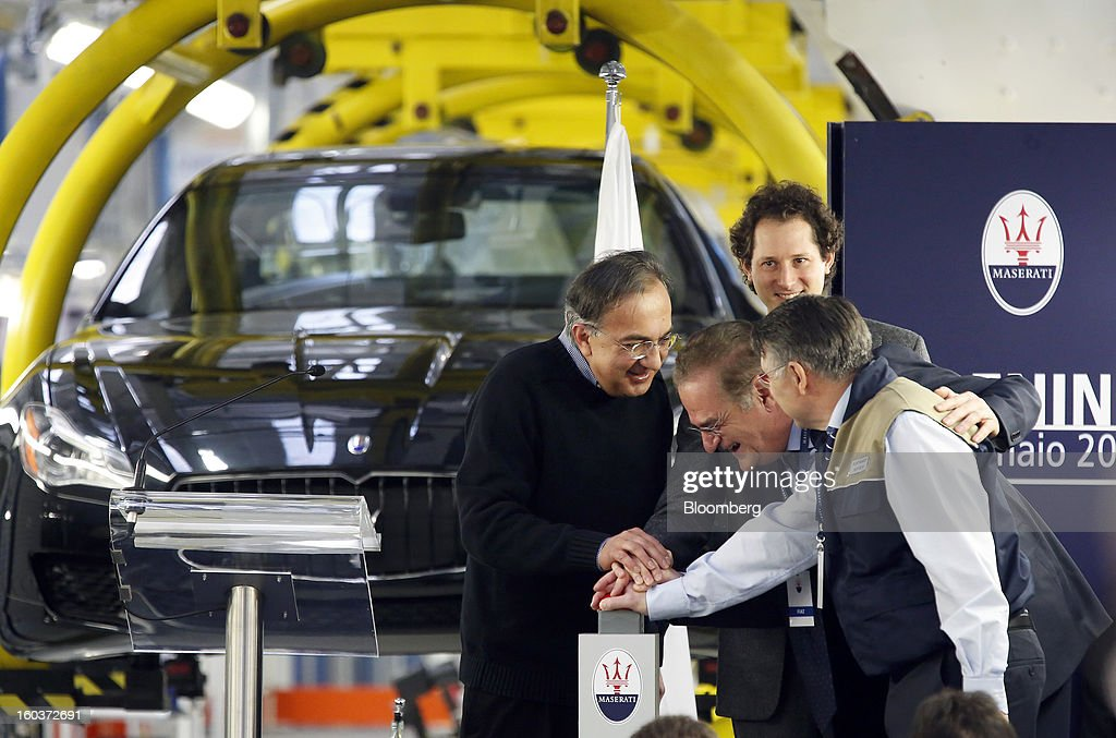 Sergio Marchionne, chief executive officer of Fiat SpA, left, and John Elkann, chairman of Fiat SpA, second right, help officially launch the Maserati Quattroporte production line at the company's Grugliasco factory in Turin, Italy, on Wednesday, Jan. 30, 2013. Sergio Marchionne said the Italian carmaker narrowed losses in Europe in the fourth quarter, helping it achieve full-year earnings that were in line with its forecasts. Photographer: Alessia Pierdomenico/Bloomberg via Getty Images