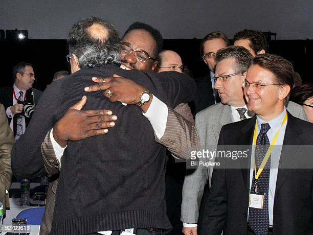 Sergio Marchionne Chrysler Group LLC Chief Executive Officer and Fiat CEO hugs United Auto Workers Vice President General Holiefield as arrives to...