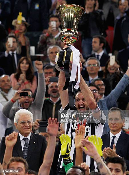 Sergio Mattarella President of Italy watches as Giorgio Chiellini of Juventus FC holds the trophy after winning the TIM Cup final match against SS...