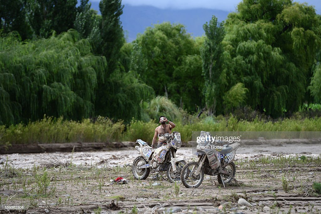 Sergio Miquel Petrone of MED Racing Team takes a break after the stage from Salta to Tucuman was interupted by a flash flood during the 2013 Dakar Rally on January 12, 2012 in Salta, Argentina.