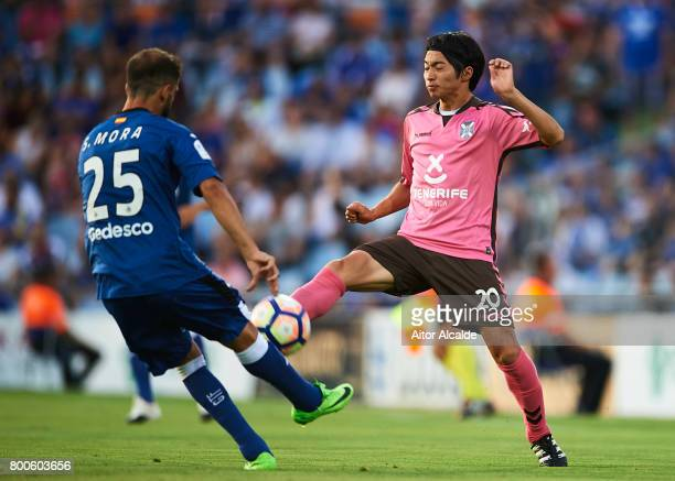Sergio Mora of Getafe CF competes for the ball with Gaku Shibasaki of CD Tenerife during La Liga 2 play off round between Getafe and CD Tenerife at...