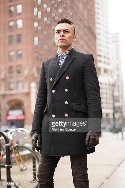 Sergio Nares is seen on Michigan Avenue wearing a black wool Zara coat Diesel black/grey poker dot cotton shirt black leather gloves brown pants and...