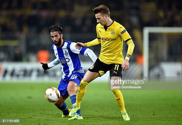 Sergio Oliveira of FC Porto and Marco Reus of Borussia Dortmund compete for the ball during the UEFA Europa League round of 32 first leg match...