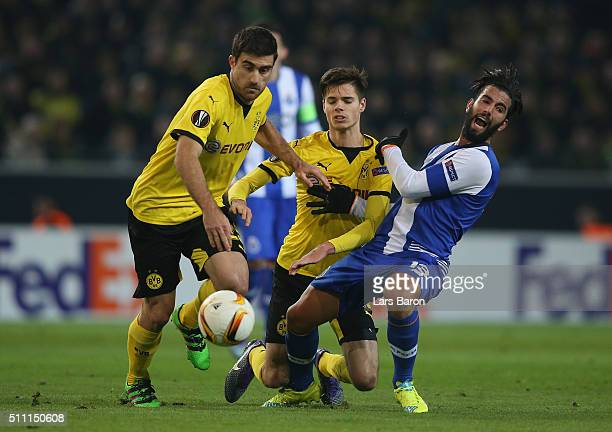 Sergio Oliveira of FC Porto competes for the ball against Sokratis Papastathopoulos and Julian Weigl of Borussia Dortmund during the UEFA Europa...