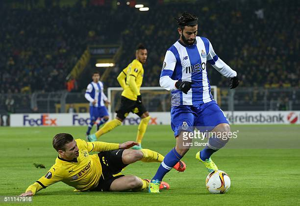 Sergio Oliveira of FC Porto is tackled by Lukasz Piszczek of Borussia Dortmund during the UEFA Europa League round of 32 first leg match between...