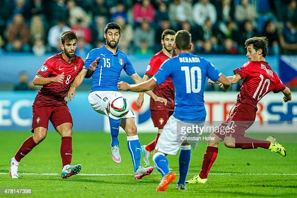 Sergio Oliveira of Portugal and Bernardo Silva compete for the ball with Marco Benassi of Italy during the UEFA Under21 European Championship 2015...