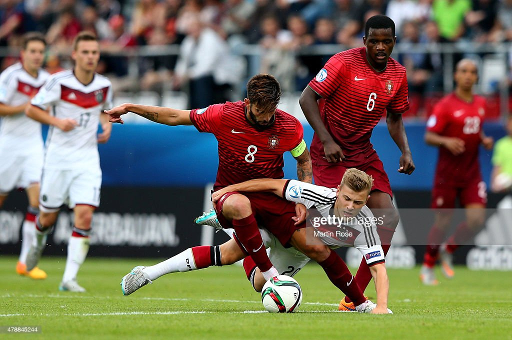 Sergio Oliveira (L) of Portugal and Max Meer of Germany battle for the ball during the UEFA European Under-21 semi final match Between Portugal and Germany at Ander Stadium on June 27, 2015 in Olomouc, Czech Republic.