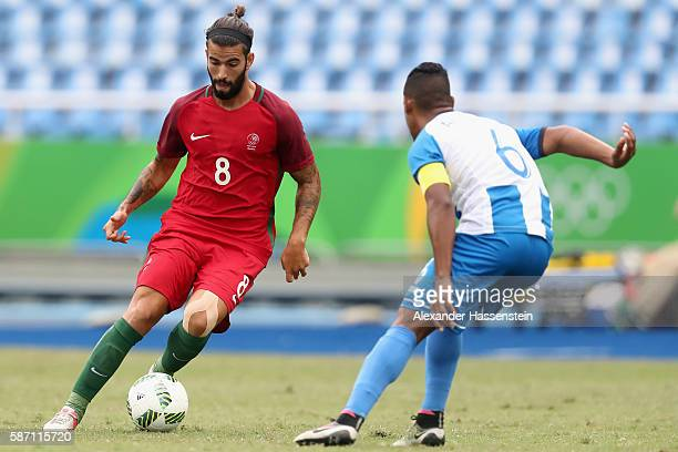 Sergio Oliveira of Portugal battles for the ball with Bryan Acosta of Honduras during the Men's Group D first round match between Honduras and...