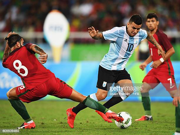 Sergio Oliveira of Portugal challenges Angel Correa of Argentina during the Olympic Men's Football match between Portugal and Argentina at Olympic...