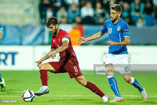 Sergio Oliveira of Portugal competes for the ball with Domenico Berardi of Italy during the UEFA Under21 European Championship 2015 match between...