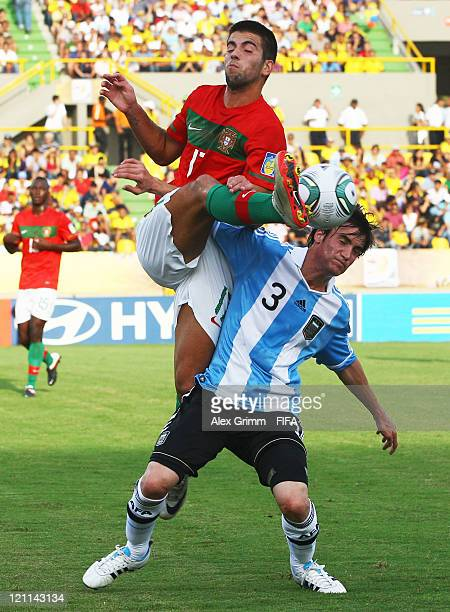 Sergio Oliveira of Portugal is challenged by Nicolas Tagliafico of Argentina during the FIFA U20 World Cup 2011 quarter final match between Portugal...