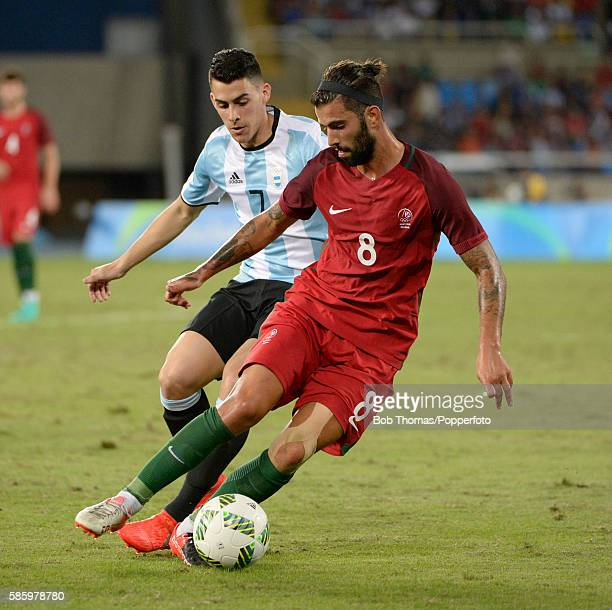 Sergio Oliveira of Portugal with Cristian Pavon of Argentina during the Men's Group D first round match between Portugal and Argentina during the Rio...