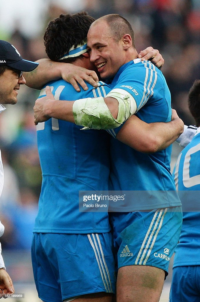 <a gi-track='captionPersonalityLinkClicked' href=/galleries/search?phrase=Sergio+Parisse&family=editorial&specificpeople=648570 ng-click='$event.stopPropagation()'>Sergio Parisse</a> (R) and teammate of Italy celebrate their team's victory at the end of the RBS Six Nations match between Italy and Ireland at Stadio Olimpico on March 16, 2013 in Rome, Italy.