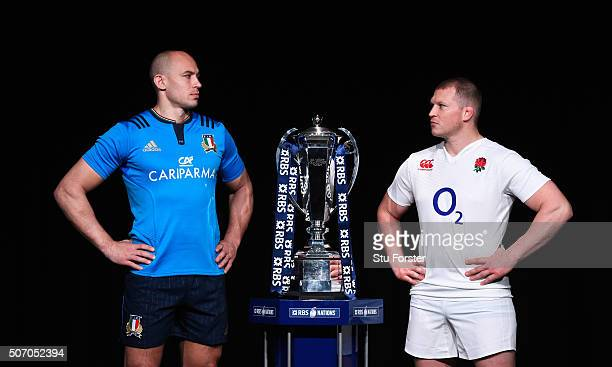 Sergio Parisse captain of Italy and Dylan Hartley captain of England pose with the trophy during the RBS Six Nations launch at The Hurlingham Club on...