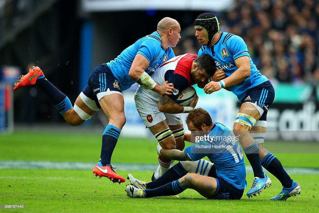 Sergio Parisse, Francesco Minto and Gonzalo Garcia of Italy tackle Damien Chouly of France during the RBS Six Nations match between France and Italy at Stade de France on February 6, 2016 in Paris, France.