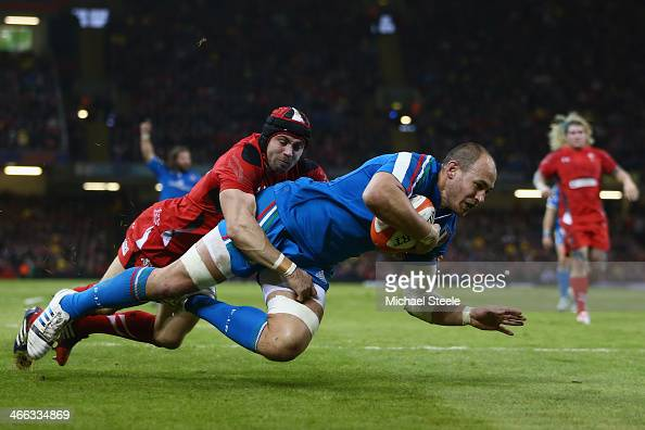 Sergio Parisse of Italy crosses the try line as Leigh Halfpenny of Wales challenges only for the try to be disallowed during the RBS Six Nations...