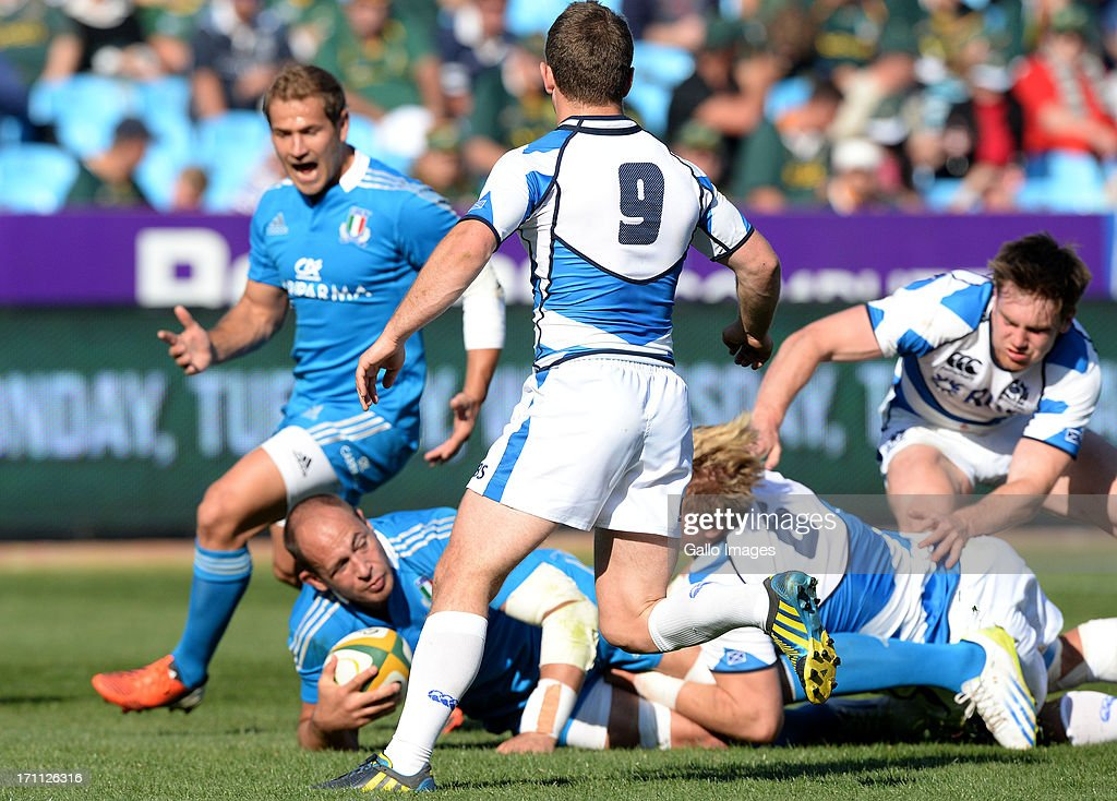 Sergio Parisse of Italy gets tackled during the Castle Larger Incoming Tour match between Italy and Scotland at Loftus Versfeld on June 22, 2013 in Pretoria, South Africa.