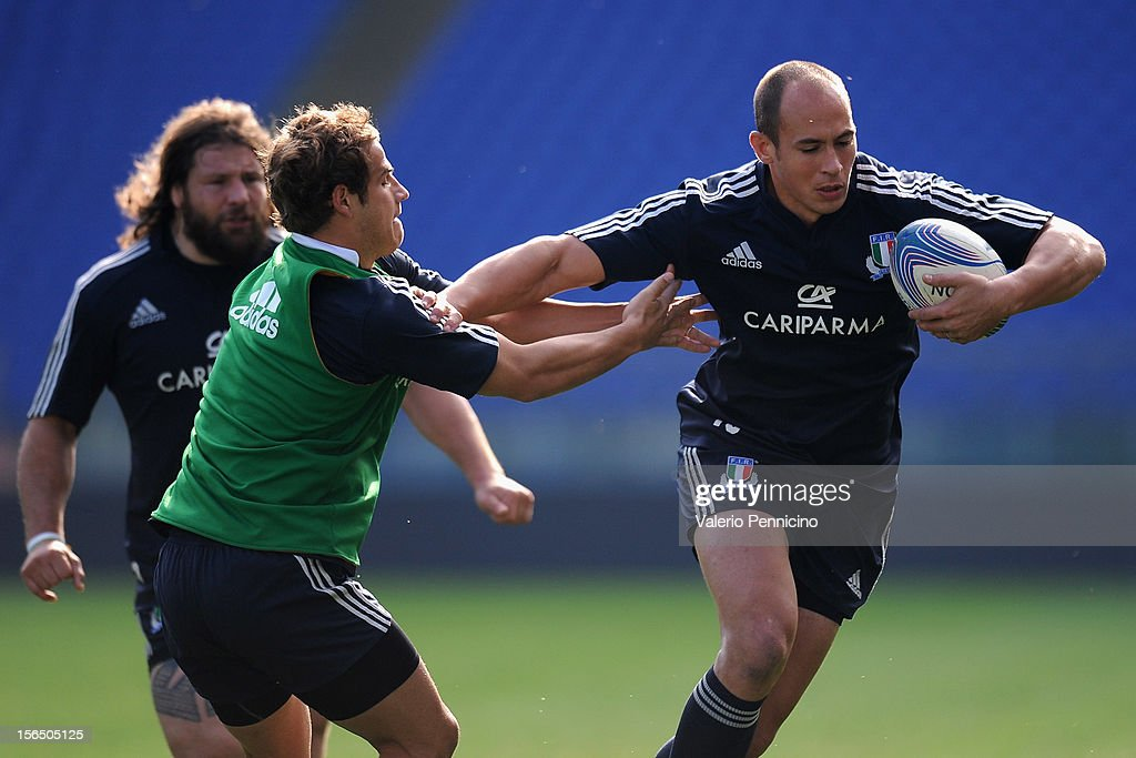 <a gi-track='captionPersonalityLinkClicked' href=/galleries/search?phrase=Sergio+Parisse&family=editorial&specificpeople=648570 ng-click='$event.stopPropagation()'>Sergio Parisse</a> (R) of Italy in action during a training session at Stadio Olimpico on November 16, 2012 in Rome, Italy.