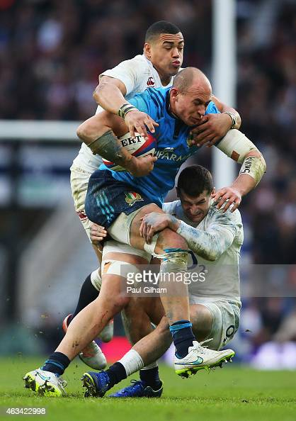 Sergio Parisse of Italy is tackled by Luther Burrell and Jonny May of England during the RBS Six Nations match between England and Italy at...