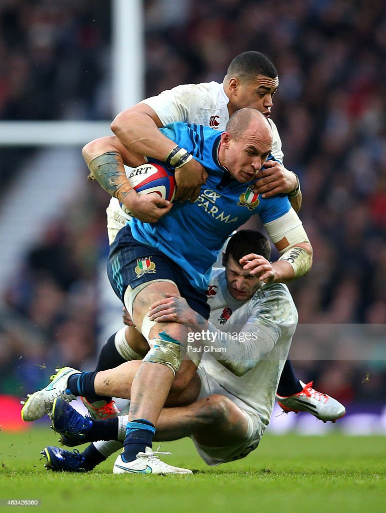 <a gi-track='captionPersonalityLinkClicked' href=/galleries/search?phrase=Sergio+Parisse&family=editorial&specificpeople=648570 ng-click='$event.stopPropagation()'>Sergio Parisse</a> of Italy is tackled by <a gi-track='captionPersonalityLinkClicked' href=/galleries/search?phrase=Luther+Burrell&family=editorial&specificpeople=871965 ng-click='$event.stopPropagation()'>Luther Burrell</a> and <a gi-track='captionPersonalityLinkClicked' href=/galleries/search?phrase=Jonny+May&family=editorial&specificpeople=5813545 ng-click='$event.stopPropagation()'>Jonny May</a> of England during the RBS Six Nations match between England and Italy at Twickenham Stadium on February 14, 2015 in London, England.