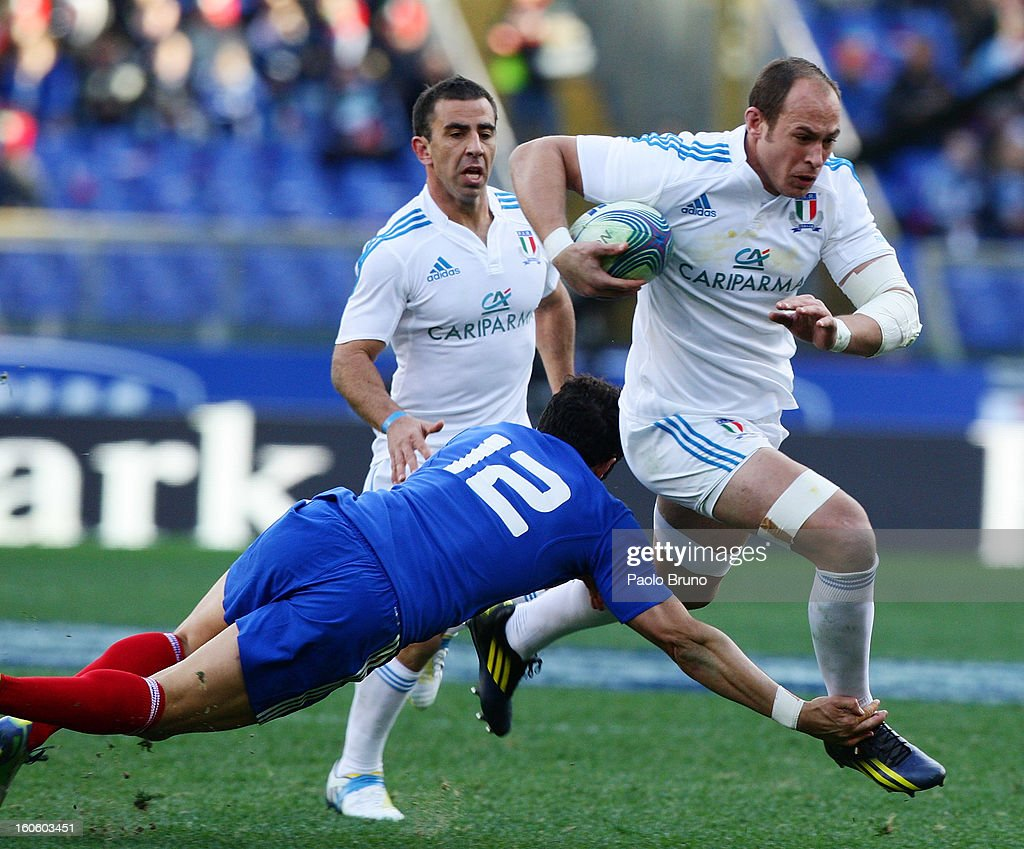 Sergio Parisse (R) of Italy is tackled by Maxime Mermoz of France during the RBS Six Nations match between Italy and France at Stadio Olimpico on February 3, 2013 in Rome, Italy.