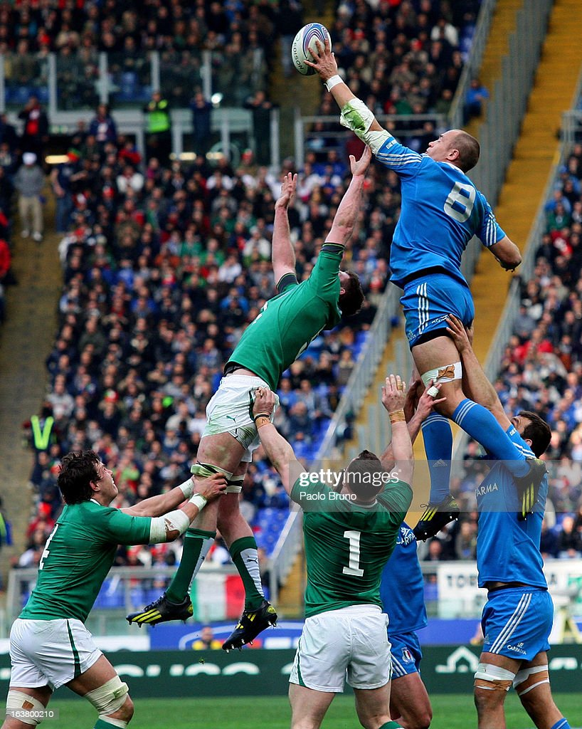 <a gi-track='captionPersonalityLinkClicked' href=/galleries/search?phrase=Sergio+Parisse&family=editorial&specificpeople=648570 ng-click='$event.stopPropagation()'>Sergio Parisse</a> (top R) of Italy jumps in the lineout during the RBS Six Nations match between Italy and Ireland at Stadio Olimpico on March 16, 2013 in Rome, Italy.